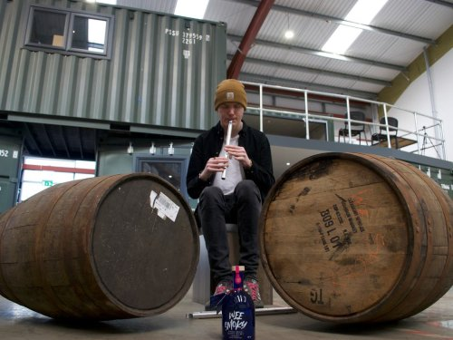 This piper is serenading casks of whisky to 'enhance its flavour'