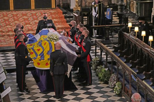 Prince Philip's coffin lowered into royal vault by electric motor