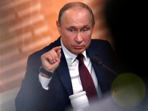 Putin says presidential term limits 'can be abolished'