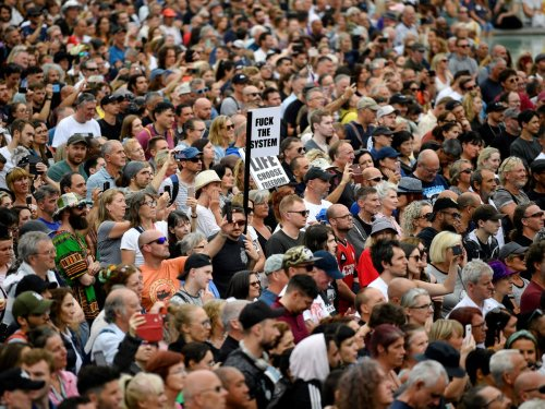 Thousands of anti-vaccine protesters gather in London