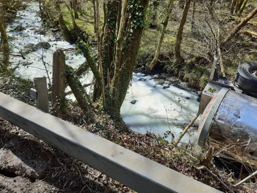 River turns white after milk truck overturns