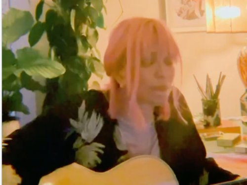 Courtney Love in tears during cover of Britney Spears song 'Lucky'
