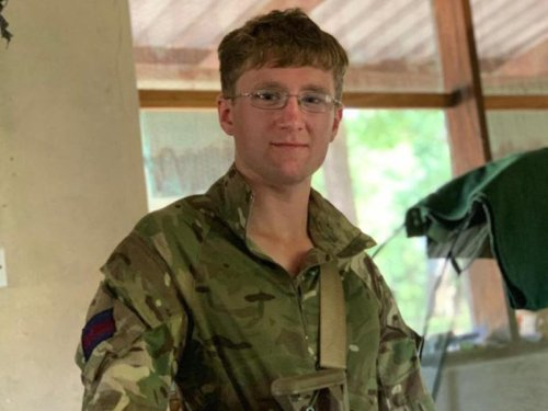 British soldier tried to climb a tree to escape elephant charge, inquest told