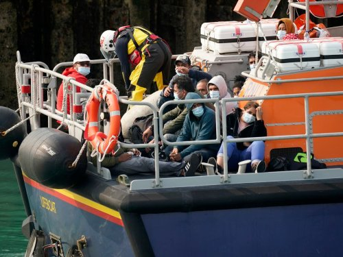 Raab claims approach to Channel crossings 'consistent' with RNLI migrant rescues – follow live