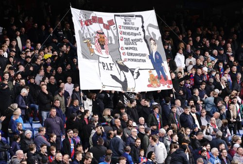 Police looking into Crystal Palace fans group banner in protest at Newcastle takeover