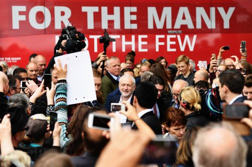 Jeremy Corbyn is back on the sidelines and he's never looked happier