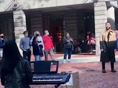John Legend hugs and tips busker who performs his song