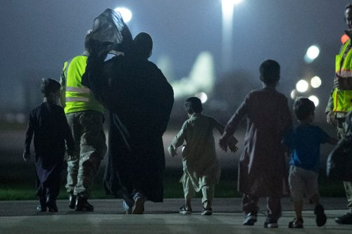 Government accused of lowering cap on Afghan refugees by 10 per cent