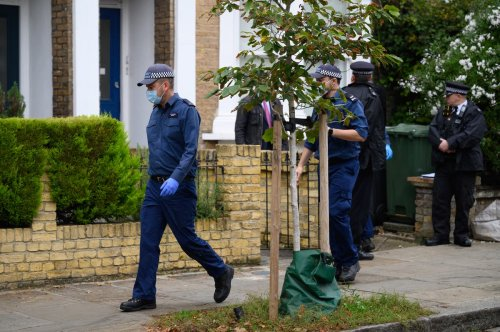 Neighbours' 'shock' as police search London flat in MP murder investigation