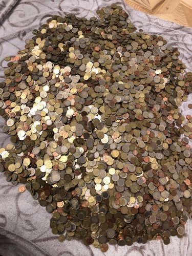 Man saves every coin he's been given over five years - see the 135lb haul