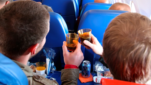 Vaccinated travellers should still avoid eating and drinking on planes, these experts say