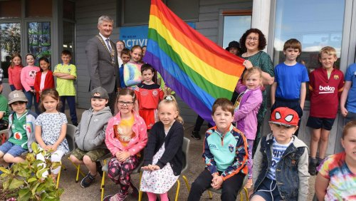 INTO spreads inclusivity message with Pride flag in schools