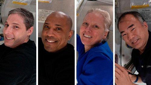 SpaceX returns four astronauts to Earth in rare night splashdown