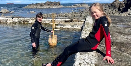 The swashbuckling brothers, aged 8 and 11, sending their model boat on an Antarctic expedition