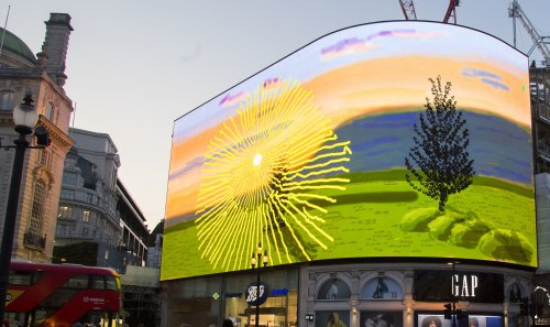 Crowds gather to view David Hockney's latest work of art in Piccadilly Circus