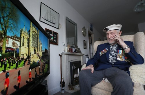 WWII veteran who fought alongside Prince Philip watched the funeral in his Royal Navy uniform