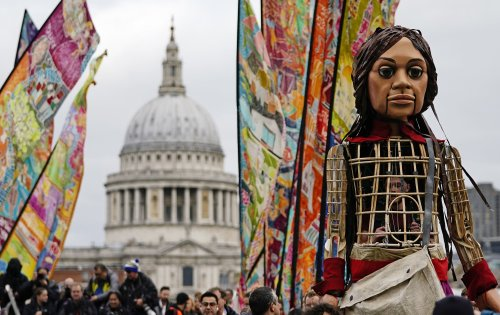 A giant puppet of a Syrian refugee has been welcomed at St Paul's Cathedral
