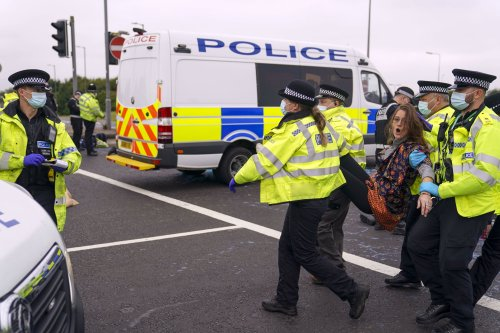 Insulate Britain activists dragged from motorway by police after running into oncoming traffic