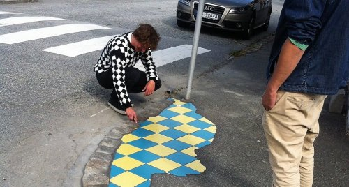 The undercover artist who fills potholes across Europe with colourful mosaics