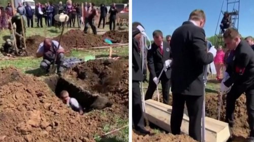 Russians Take on Challenge to Dig Graves