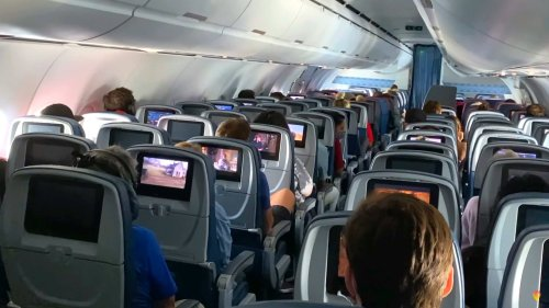Leaving the Airplane Middle Seat Open Could Reduce COVID-19 Spread, Study Says