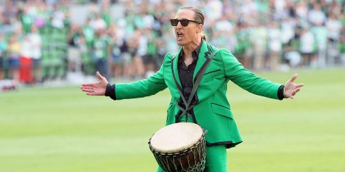 A photo shows Matthew McConaughey straddling a drum and screaming to pump up soccer fans at a new Austin stadium