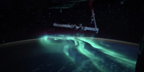 An astronaut captured stunning images of an aurora from the International Space Station
