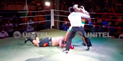 A boxing match ended in chaos when a debutant knocked his opponent down then kept trying to stamp on his head