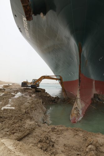It could take weeks to dislodge the ship stuck in the Suez Canal, straining a vital supply chain route