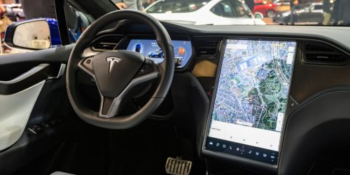 Tesla drivers with a favorable safety score can now request its Full Self-Driving beta, despite criticism from regulators