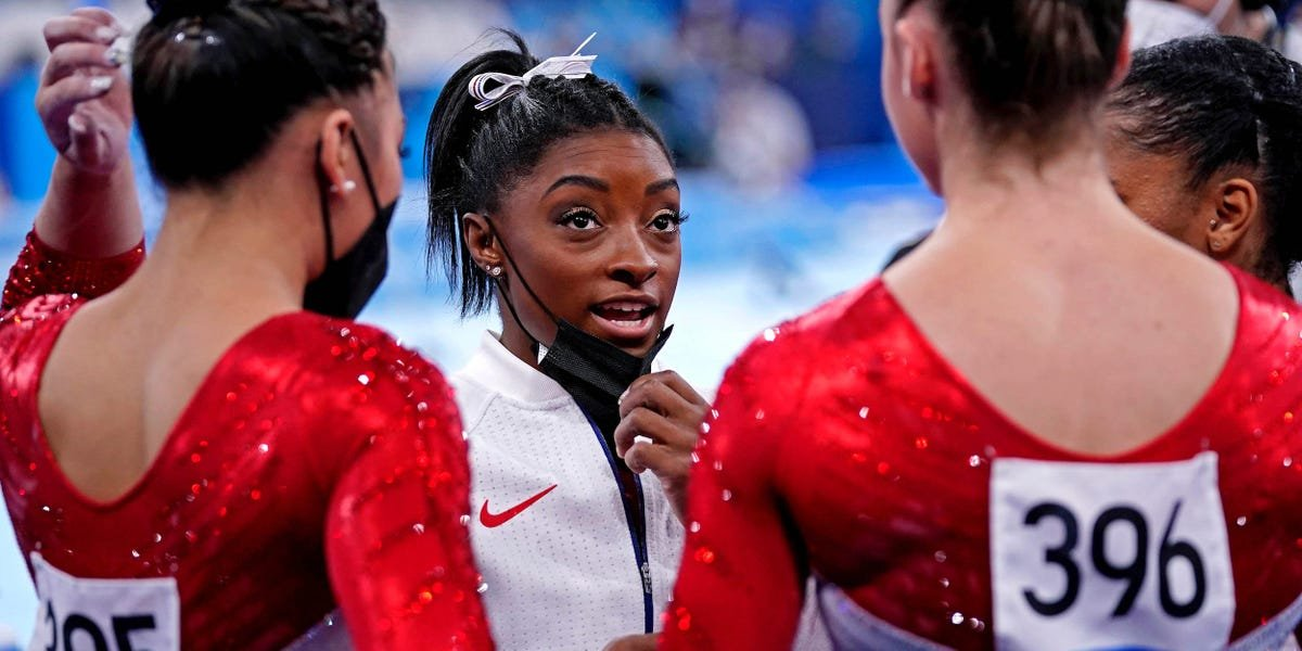 Simone Biles coached and cheered on her Team USA teammates after pulling out of the Olympics team all-around final