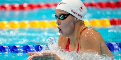 An Olympic medalist admitted on live TV that she was 'sh------ herself' while swimming her relay leg