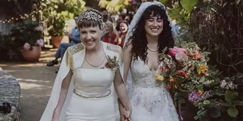 YouTuber Hannah Hart got married in a white pantsuit and cape that matched her bride's sparkling gown
