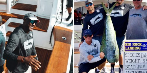 Michael Jordan caught a dolphin to capture an early lead in a $3.4 million fishing tournament in North Carolina