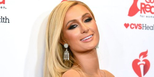 Paris Hilton says the viral photo of her in a 'Stop Being Poor' shirt was edited and reveals what it actually said