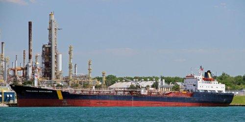 US aircraft saw suspected Iranian gunmen take something from a hijacked tanker during 7-hour incident: official