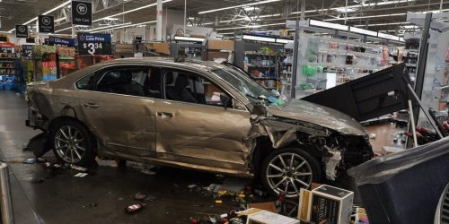 A disgruntled ex-employee left a trail of destruction in a Walmart store when he drove his car through the front doors and up the aisles