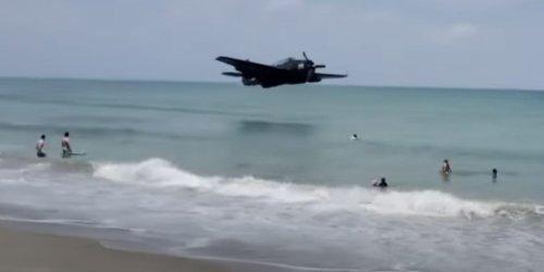 Dramatic video shows World War II-era TBM Avenger making emergency landing next to people on Florida beach