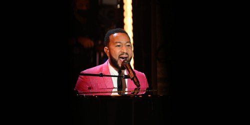 A street artist was performing John Legend's 'All of Me' when the singer-songwriter showed up in the crowd