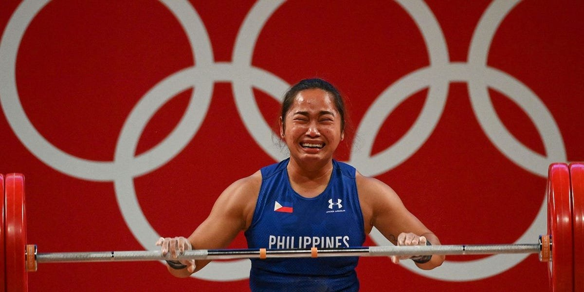 Filipino weightlifter broke down and said she planned to 'eat a lot' after winning her country's first Olympic gold medal ever