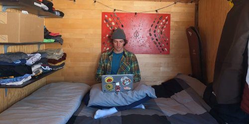 I spent 9 months in a tiny home on my employer's property with just enough room for my bed and snowboards — here's what it was like