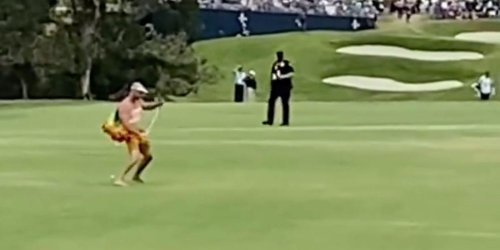 A fan stormed the course at the US Open and got in a few swings before getting tackled by security