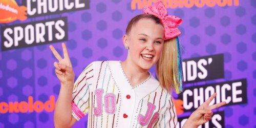 JoJo Siwa shared photos of a Disney World vacation she took with her girlfriend that included cuddling on rides and wearing matching outfits