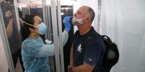 COVID-19 cases in the US near 50,000 a day — the highest since May as CDC reportedly considers stricter mask rules