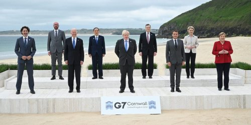 G7 leaders gathered for a 'family photo' on an English beach, and Biden joked they should jump in the water