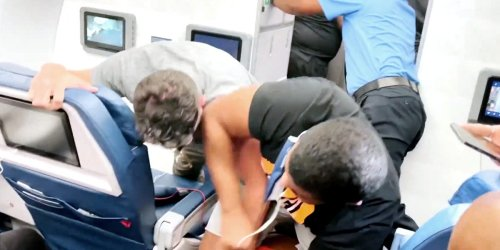 Footage shows unruly passengers fighting on planes and at airports across the US