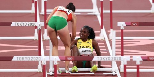 Olympic hurdler helped her opponent to her feet after the pair tumbled to the ground while racing in Tokyo