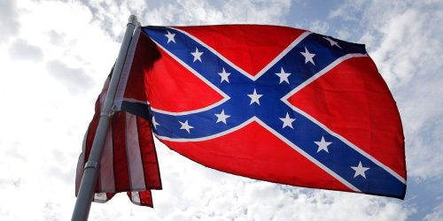 Black students in Georgia were suspended for planning a protest after white students waved a Confederate flag and allegedly used racial slurs