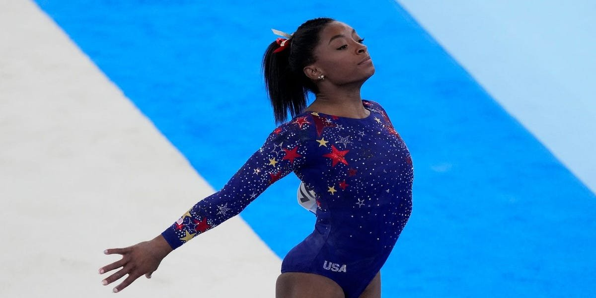 Simone Biles says it feels 'like I have the weight of the world on my shoulders' after getting second place in Olympic prelims