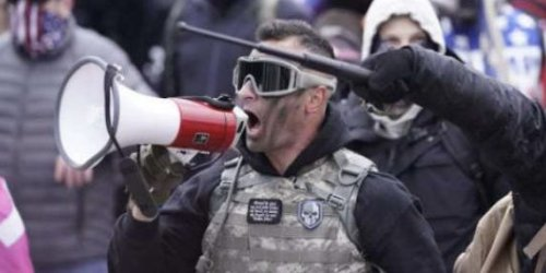 Capitol riot suspect who bragged about macing cops, posed for pictures with Trump allies has been charged with assault